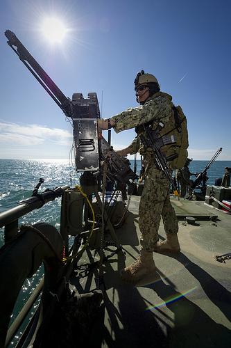 Electronics Technician 3rd Class Richard Zapada mans an M240 machine gun.